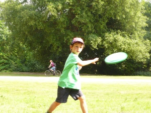 My son playing frisbee